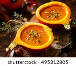 pumpkin soup served in a... | Shutterstock . vector #495312805