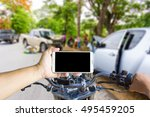 man using a cell phone while... | Shutterstock . vector #495459205