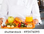 cook in a school with a tray of ... | Shutterstock . vector #495476095
