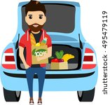 the young man puts shopping in... | Shutterstock .eps vector #495479119