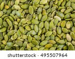 organic pumpkin seeds in a clay ... | Shutterstock . vector #495507964