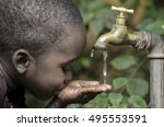 baby boy drinks water from tap... | Shutterstock . vector #495553591