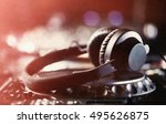 headphones on cd music disc... | Shutterstock . vector #495626875