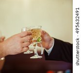 guests clang glasses together... | Shutterstock . vector #495632491