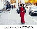 Young Stylish Woman Wearing Re...