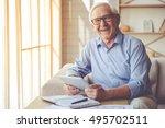 handsome old man in eyeglasses... | Shutterstock . vector #495702511