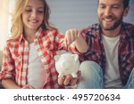 pretty girl is putting a coin... | Shutterstock . vector #495720634