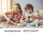 pretty little girl and boy are... | Shutterstock . vector #495723247