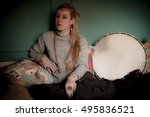 Blond Woman With  Tambourine