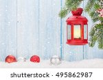 christmas candle lantern on fir ... | Shutterstock . vector #495862987