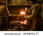 the blacksmith forging the... | Shutterstock . vector #495895177