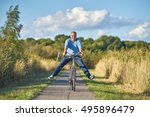 active senior on bike in spring ... | Shutterstock . vector #495896479