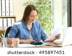 freelance woman calculating a... | Shutterstock . vector #495897451