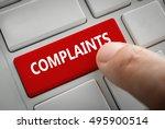 Stock photo close view of male hand touching the complaints button complaints concept 495900514