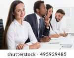 smiling woman is sitting next... | Shutterstock . vector #495929485