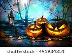 Halloween Pumpkins On Wood In...