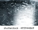 Wet Asphalt With Raindrops On...