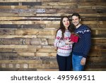 Young Couple Near Wooden Wall...