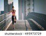 female runner stretching.  | Shutterstock . vector #495973729