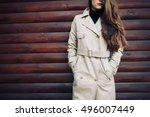 woman in beige coat outdoors...   Shutterstock . vector #496007449