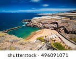 Small photo of small cozy Abama beach and banana plantations on the background, Tenerife, Canary islands