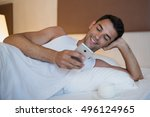 handsome smiling young man... | Shutterstock . vector #496124965