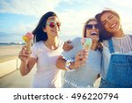 laughing teenage girls eating... | Shutterstock . vector #496220794