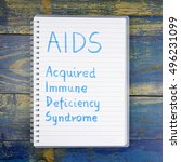 Small photo of AIDS- Acquired Immune Deficiency Syndrome written in notebook on wooden background