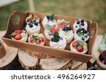 cakes with berries lie on a... | Shutterstock . vector #496264927