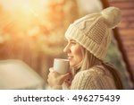 female in white with cup of... | Shutterstock . vector #496275439