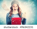 happy young woman opening a... | Shutterstock . vector #496342231