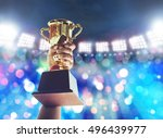 win concept.man holding up a... | Shutterstock . vector #496439977