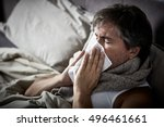 sick man with cold lying in bed ... | Shutterstock . vector #496461661