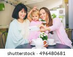 family portrait in cafe. aged... | Shutterstock . vector #496480681
