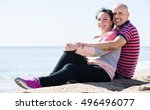 smiling mature man and a woman... | Shutterstock . vector #496496077