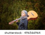 Cute Little Boy With Guitar In...