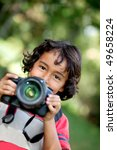 Child Photographer Holding A...