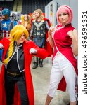 Small photo of Sheffield, UK - June 11, 2016: Cosplayers dressed as Edward Elric from 'Full Metal Alchemist' (left) and Sakura Haruno from 'Naruto' (right) at the Yorkshire Cosplay Convention at Sheffield Arena