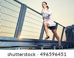 woman sprinting in city during... | Shutterstock . vector #496596451
