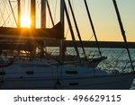 Sun Rays Through Boat Masts At...