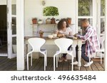 Couple At Home Eating Outdoor...