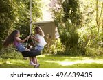 two girls playing together on... | Shutterstock . vector #496639435