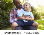 father and son having fun on... | Shutterstock . vector #496639501