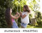 two girls playing together on... | Shutterstock . vector #496639561