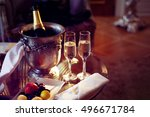 Stock photo still life romantic dinner two glasses and champagne in the ice bucket celebration or holiday 496671784