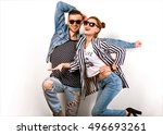 fashion couple in studio ... | Shutterstock . vector #496693261