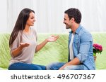 young couple is sitting at sofa ... | Shutterstock . vector #496707367
