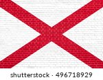 Small photo of Alabamian official flag, symbol. American patriotic element. USA banner. United States of America background. Flag of the US state of Alabama on brick wall texture background