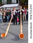 Small photo of Kerns, Switzerland - 1 October 2016: People wearing traditional clothes and playing the alphorn at Kerns on the Swiss alps