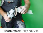 angle grinders in the hands of... | Shutterstock . vector #496733941